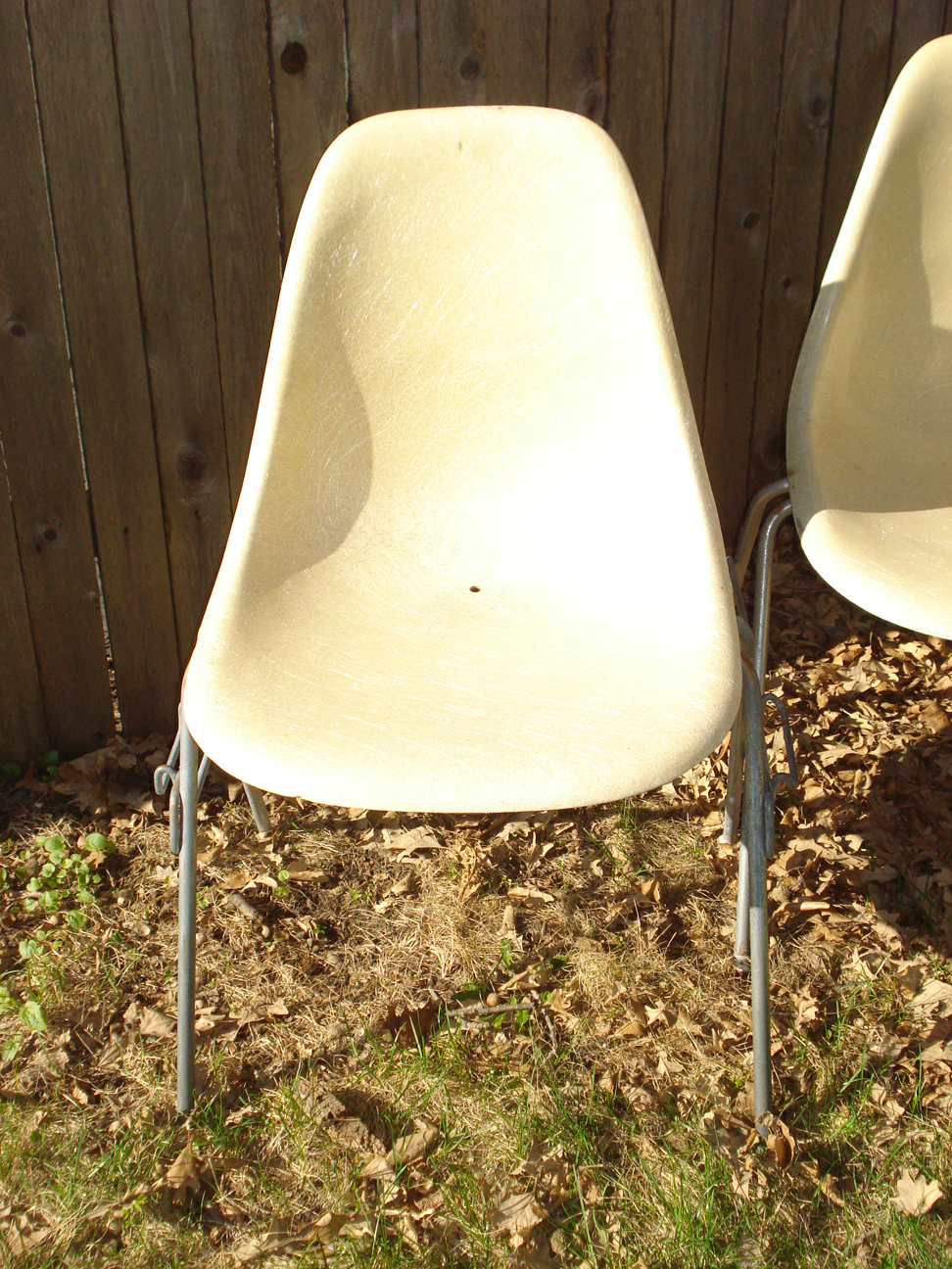 Herman Miller fiberglass shell chair with hole drilled in seat