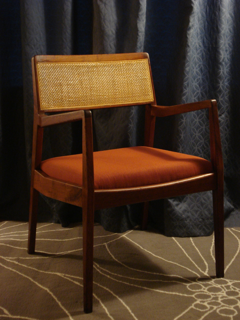 A sexy, dimly lit image of the Risom C140 Chair.