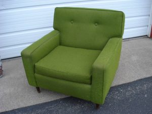 Green upholstered lounge chair