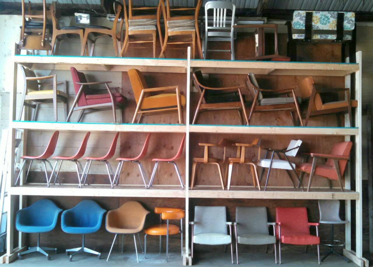 New shelving at EGW Decorative Salvage holding chair inventory, August 2015.